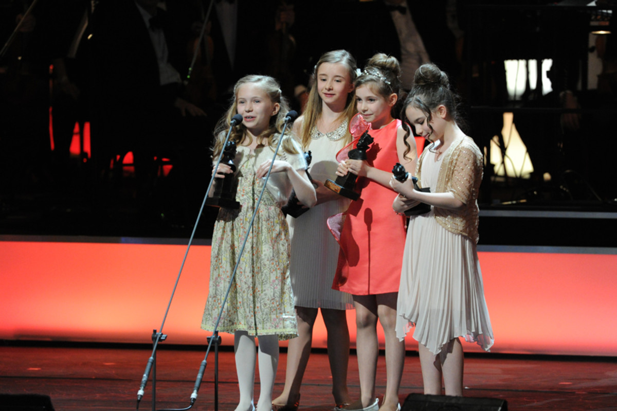 The Matildas collect the 2012 Olivier Award for Best Actress in a Musical (photo: Alastair Muir)