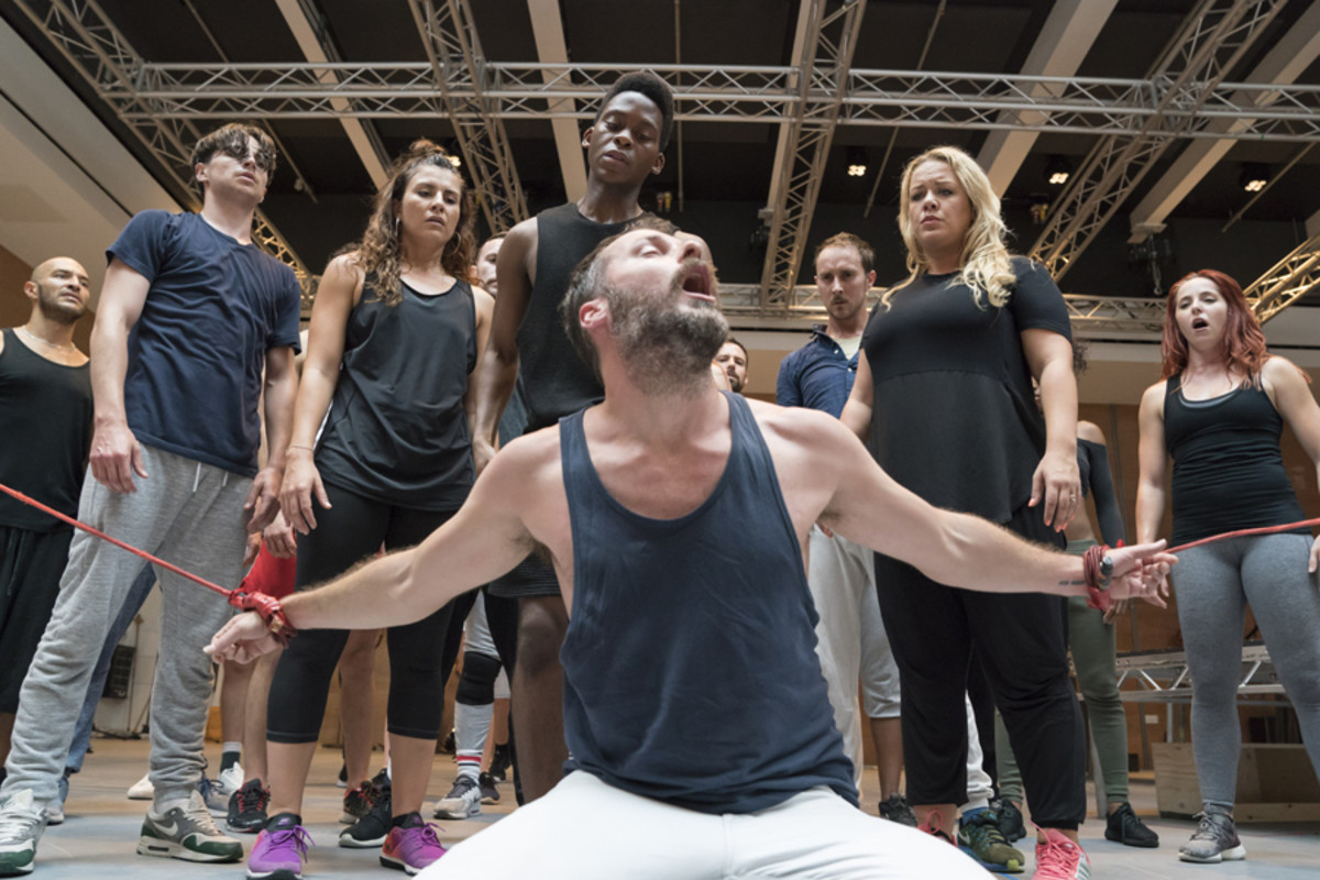 Declan Bennett and Tyrone Huntley with ensemble in rehearsals for Jesus Christ Superstar (Photo: Johan Persson)
