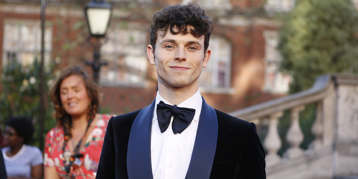 Charlie Stemp (wearing Chester Barrie) on the Olivier Awards 2017 with Mastercard red carpet (Photo: Pamela Raith)