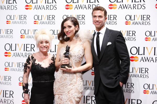 Zrinka Cvitešić, winner of the Best Actress in a Musical Award for Once, with presenters Barbara Windsor and Richard Fleeshman (Photo: Pamela Raith)