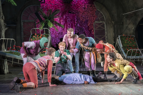 Sam Angell as Peter with the Lost Boys and Wendy - Photo Johan Persson