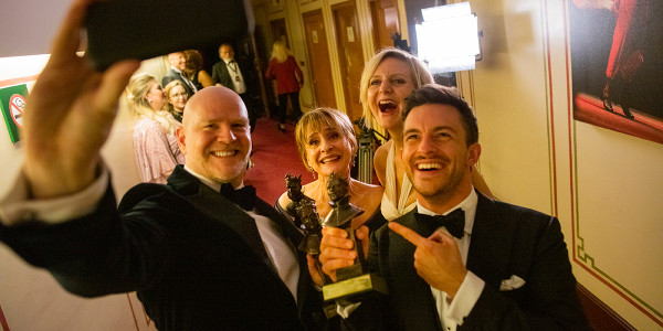 Chris Hooper, Patti LuPone, Marianne Elliott and Jonathon Bailey take a selfie with their awards for 'Company'. Photo by David Levene.