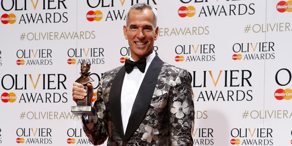 Jerry Mitchell collecting Best Costume Design on behalf of Gregg Barnes for Kinky Boots at the Olivier Awards 2016
