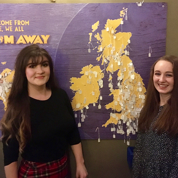 Pippa and her companion pin themselves on the Come From Away map