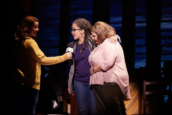 Jenna Boyd and Cat Simmons cuddle in Come From Away