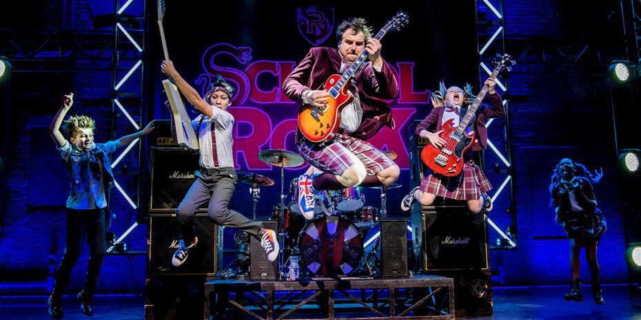 Stephen Leask and the kids cast of School Of Rock (Photo: Tristram Kenton)