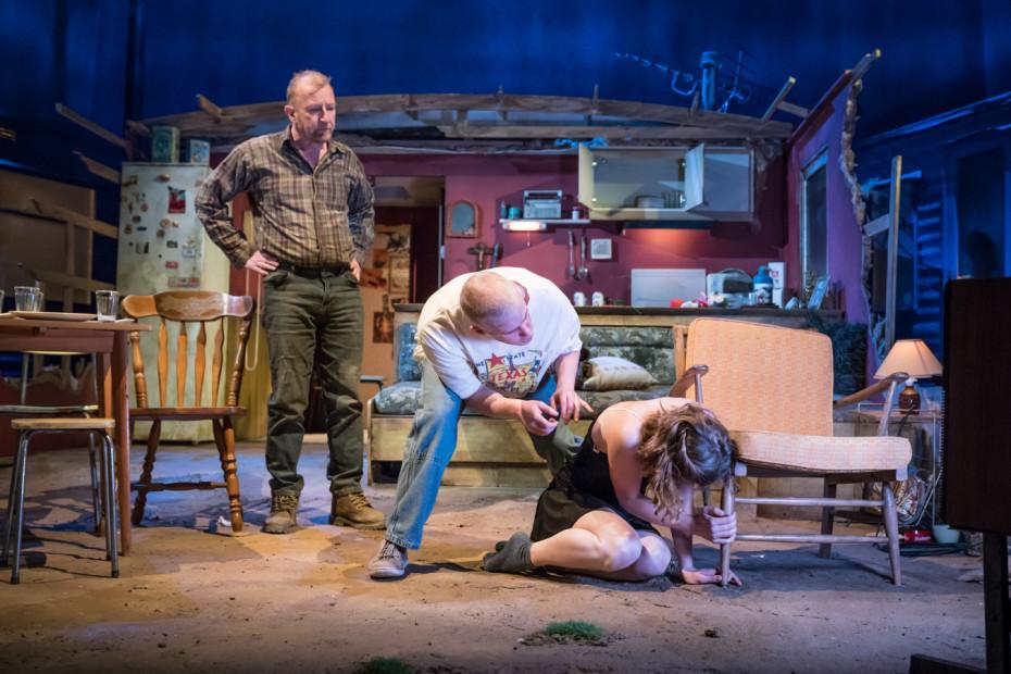 Steffan Rhodri as Ansel Smith, Adam Gillen as Chris Smith and Sophie Cookson as Dottie - Killer Joe at Trafalgar Studios - Photographer Marc Brenner