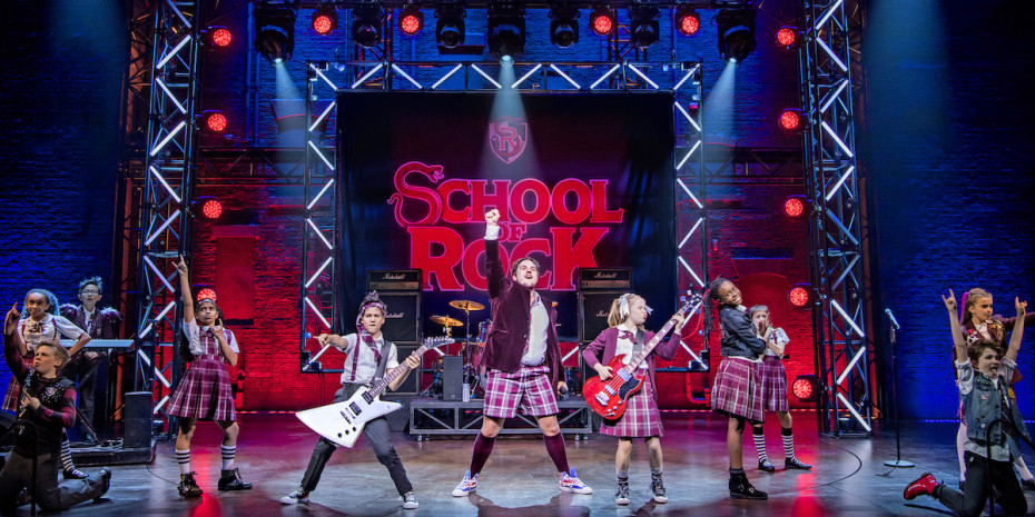 Craig Gallivan and the kids of School Of Rock. Photo credit Tristram Kenton