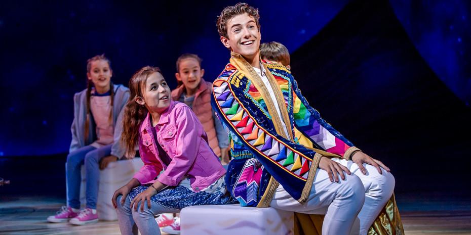 Jac Yarrow (Joseph) and the company of Joseph and the Amazing Technicolor Dreamcoat. Photographer: Tristram Kenton