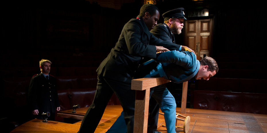 Taz Skylar as Leonard Vole and the cast of Witness for the Prosecution. Photo by Ellie Kurttz.