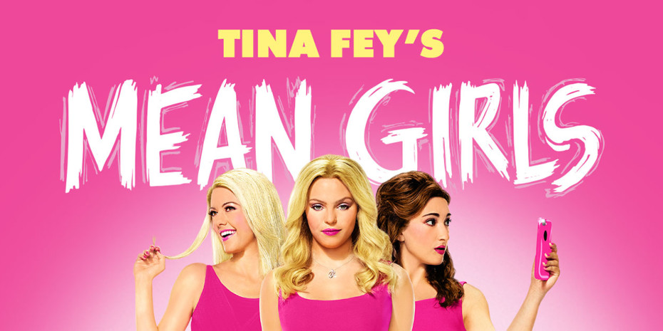 Three girls wearing pink clothing with the wording above reading Tina Fey's Mean Girls