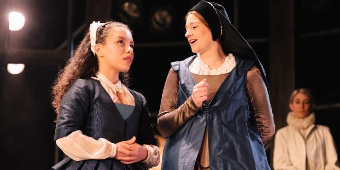 Saffron Coomber (Emilia 1) and Samantha Sutherland (Ensemble) in Emilia at the Vaudeville Theatre. Photo credit Helen Murray.
