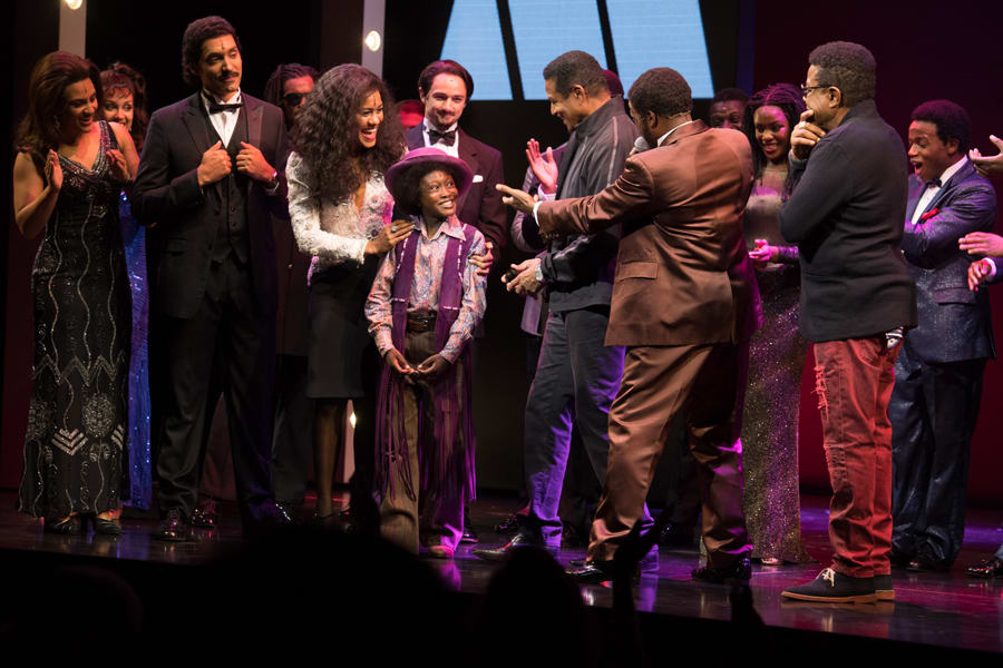 Raphael Higgins-Humes (Young Michael Jackson) and the cast of Motown The Musical with Jackie Jackson and Tito Jackson (Photo: Craig Sugden)