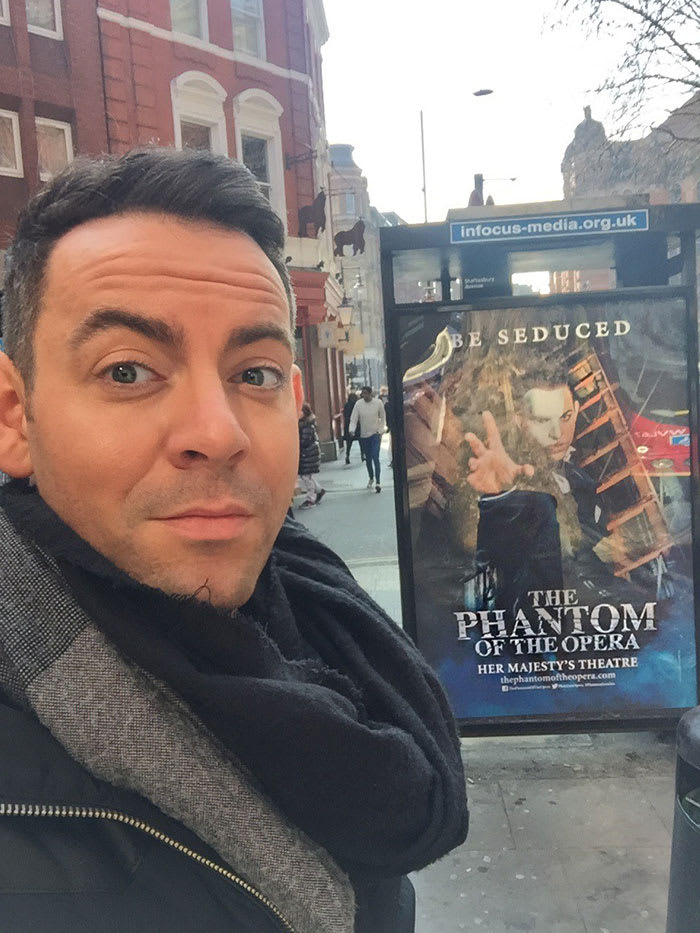 Ben Forster with a The Phantom Of The Opera poster