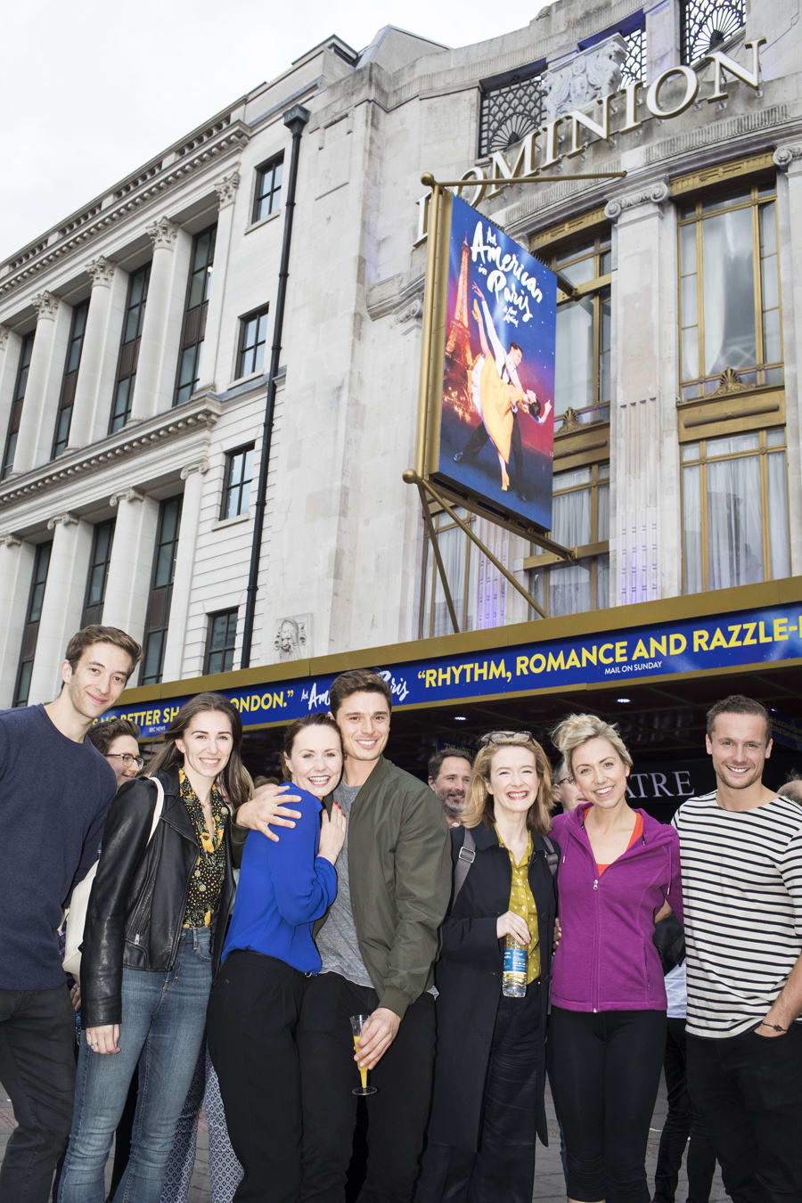 The cast of An American In Paris outside the Dominion Theatre