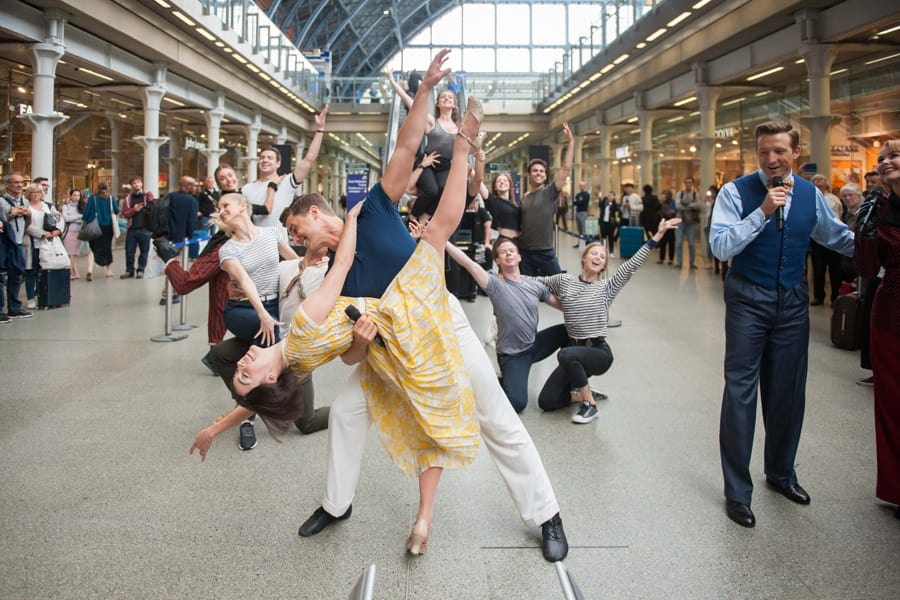 The cast of An American In Paris at St Pancras International station
