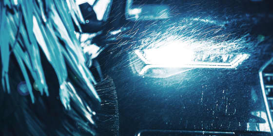 Glowing headlight in car wash