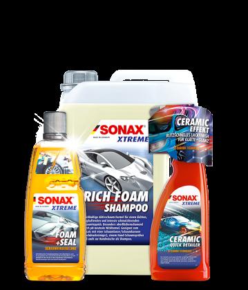 Drei Autopflege Produkte in verschiedenen Gebindegrößen