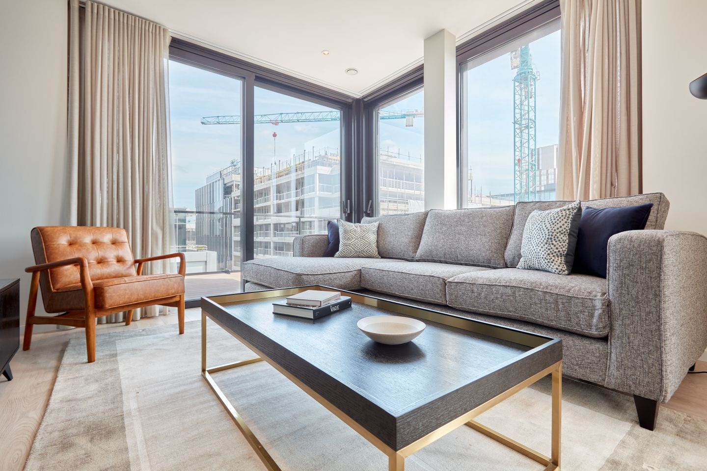 Long rectangular coffee table & grey couch of a Dublin serviced apartment by Sonder.