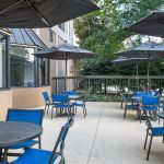 Outdoor patio with tables and umbrellas