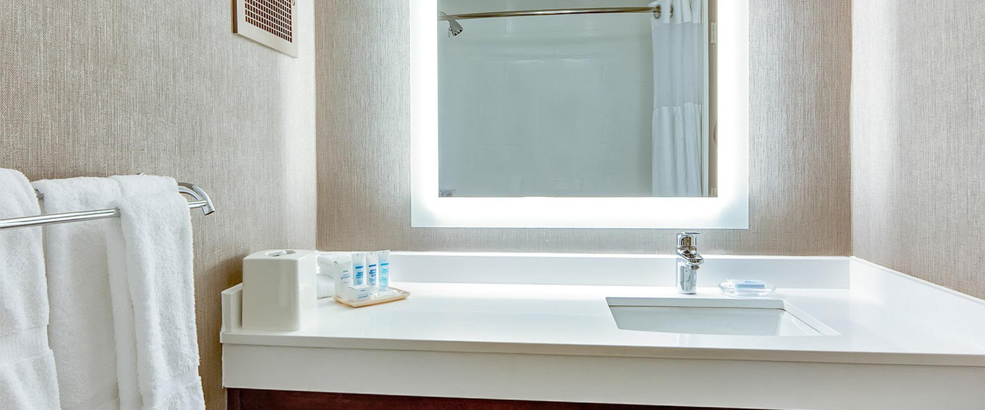 White bathroom vanity and sink