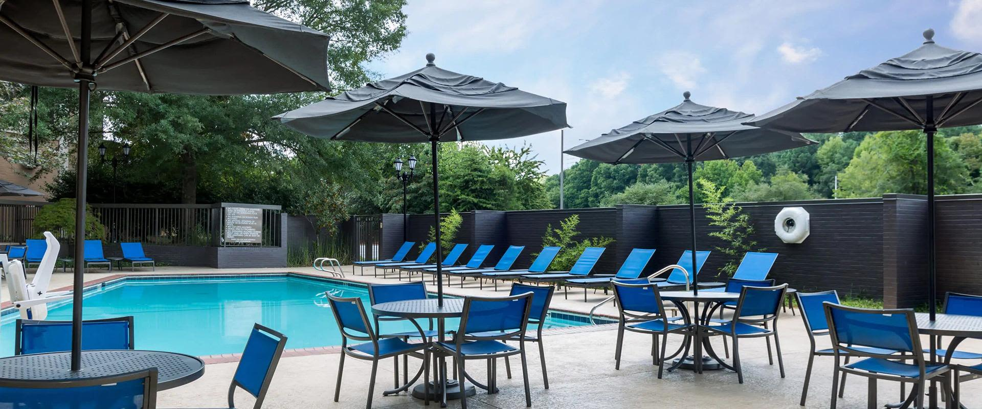 Outdoor tables and umbrellas by pool