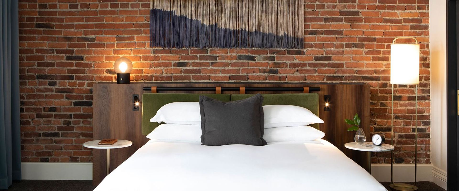 Grand Alexis Suite Brick Wall