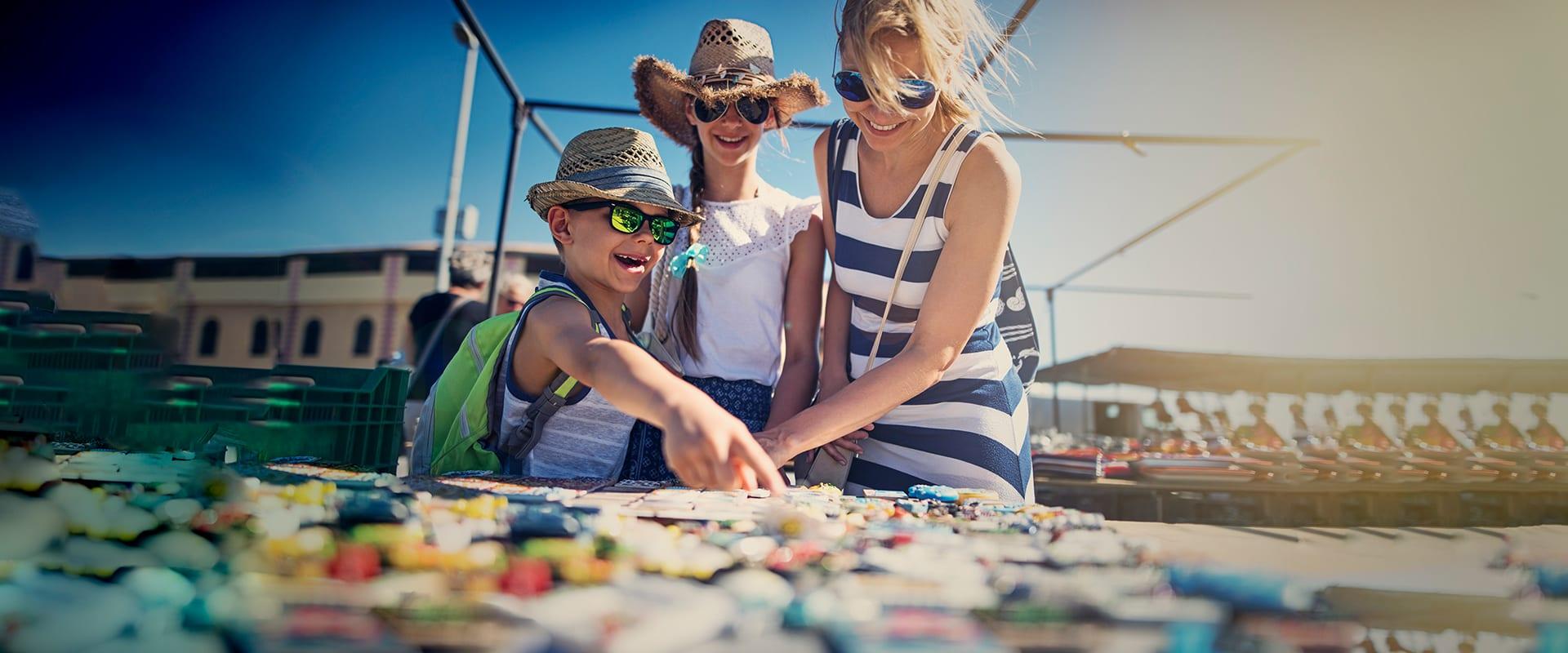 Family buying souvenirs on flea market