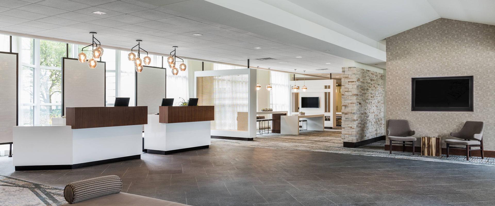 Sonesta Hamilton Park Lobby with Reception Desks and Seating