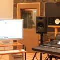 Awesome-home-recording-studio-interior-with-stone-wall-and-polished-wood-flooring