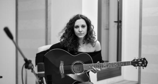 Singer, Songwriter, Guitarist - Nicole Stella