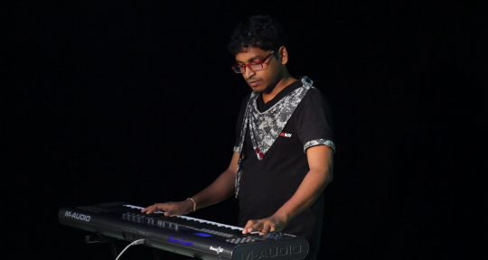 'Music Producer',  - Vinod Kumar