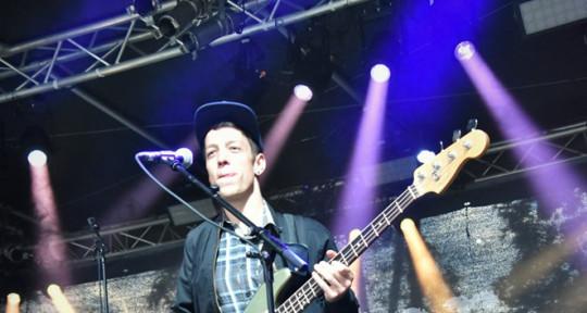 Bassist, Songwriter, Lyrics - Nik