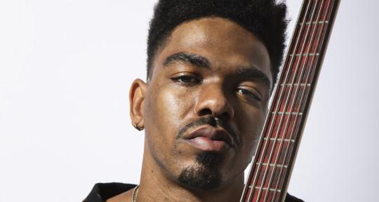 Bassist, Songwriter, Vocalist - Trip Carter