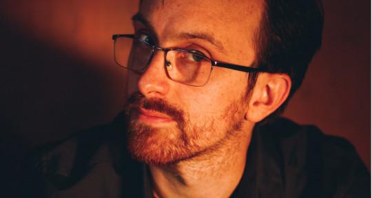 Composer, Producer, Guitarist - Julian R. Fogel