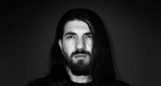 I write lyrics/do metal vocals - Karam Bassam