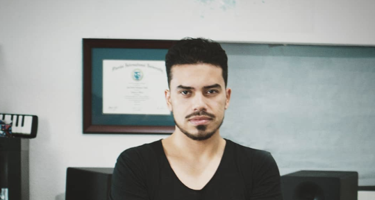 Producer,Composer, Keyboardist - Juan Tobon