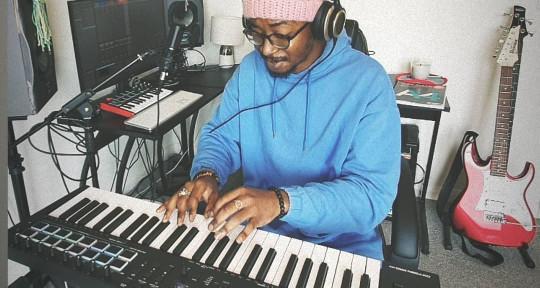 Bass guitarist, music producer - Lanre