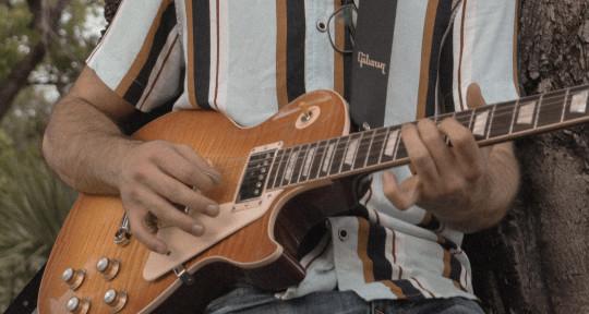 Guitarist, bassist, lyricist - Diego Aure