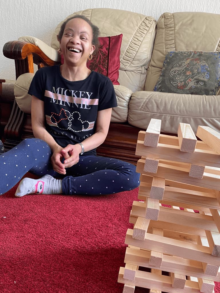 A female playing jenga