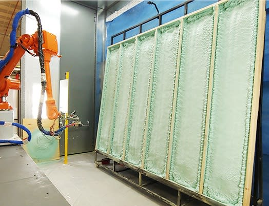 robot spraying foam on wall