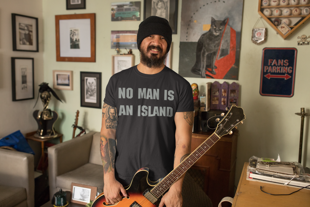 Guy with hat and guitar wearing a custom T-shirt