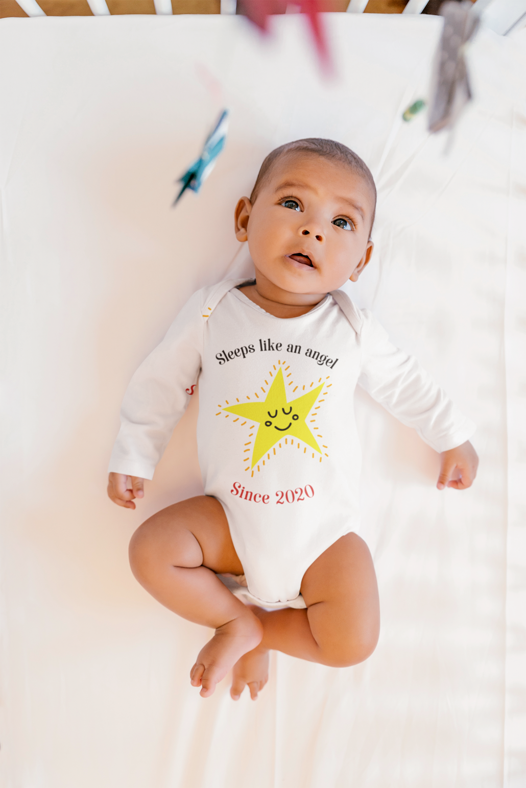 Baby with custom romper suit