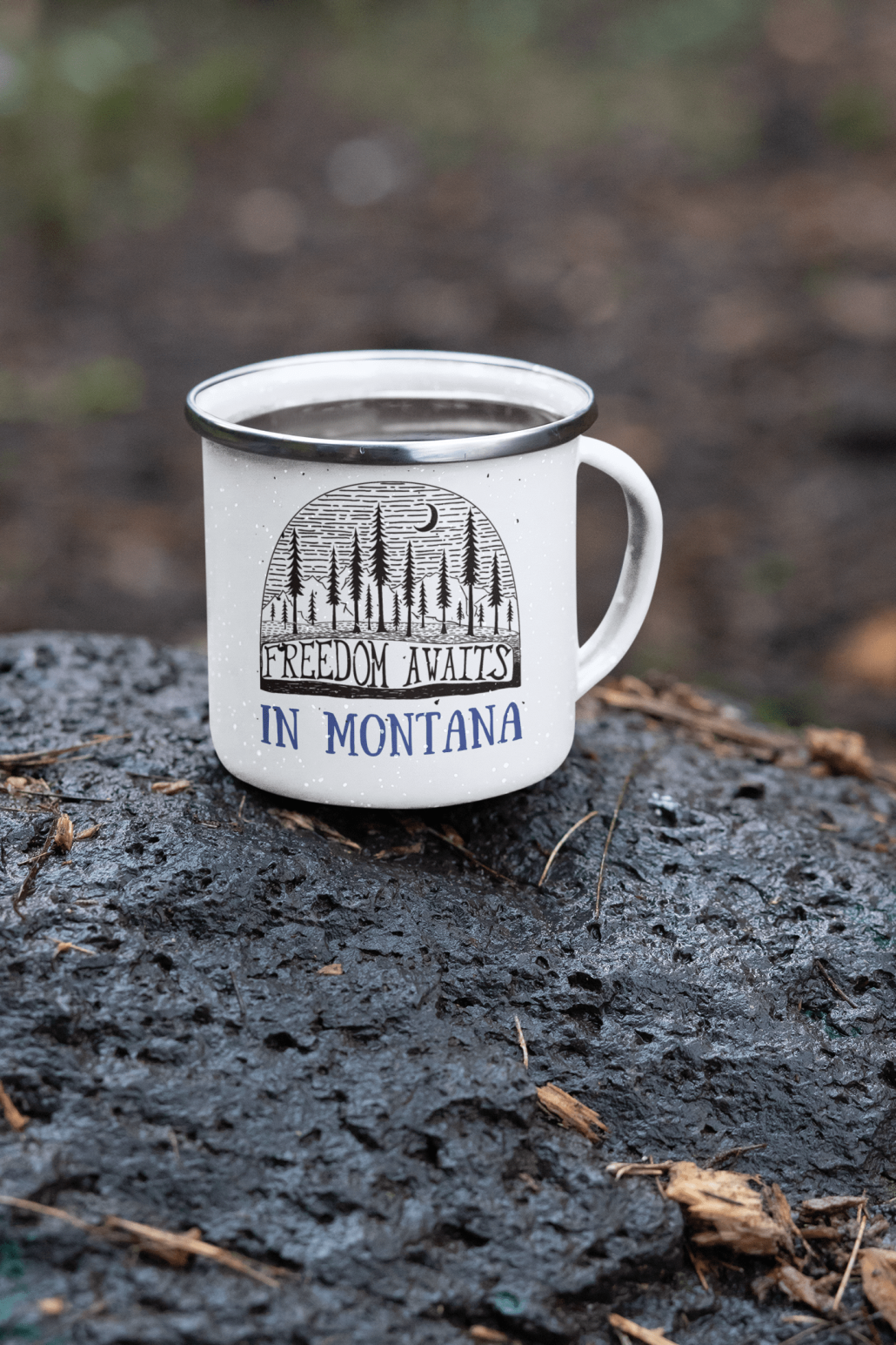 Custom camping mug on a stone in the wild
