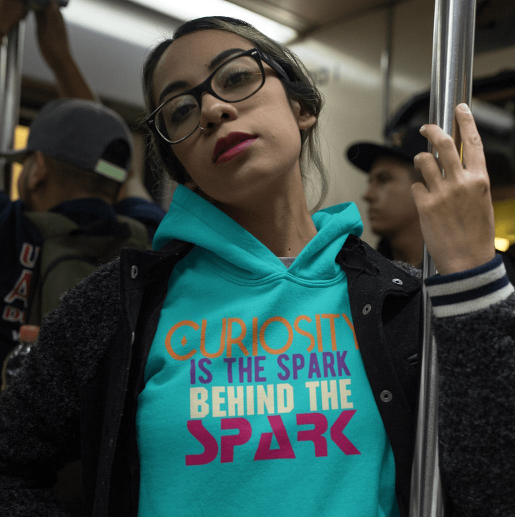 Girl with custom unisex hoodie with curiosity design