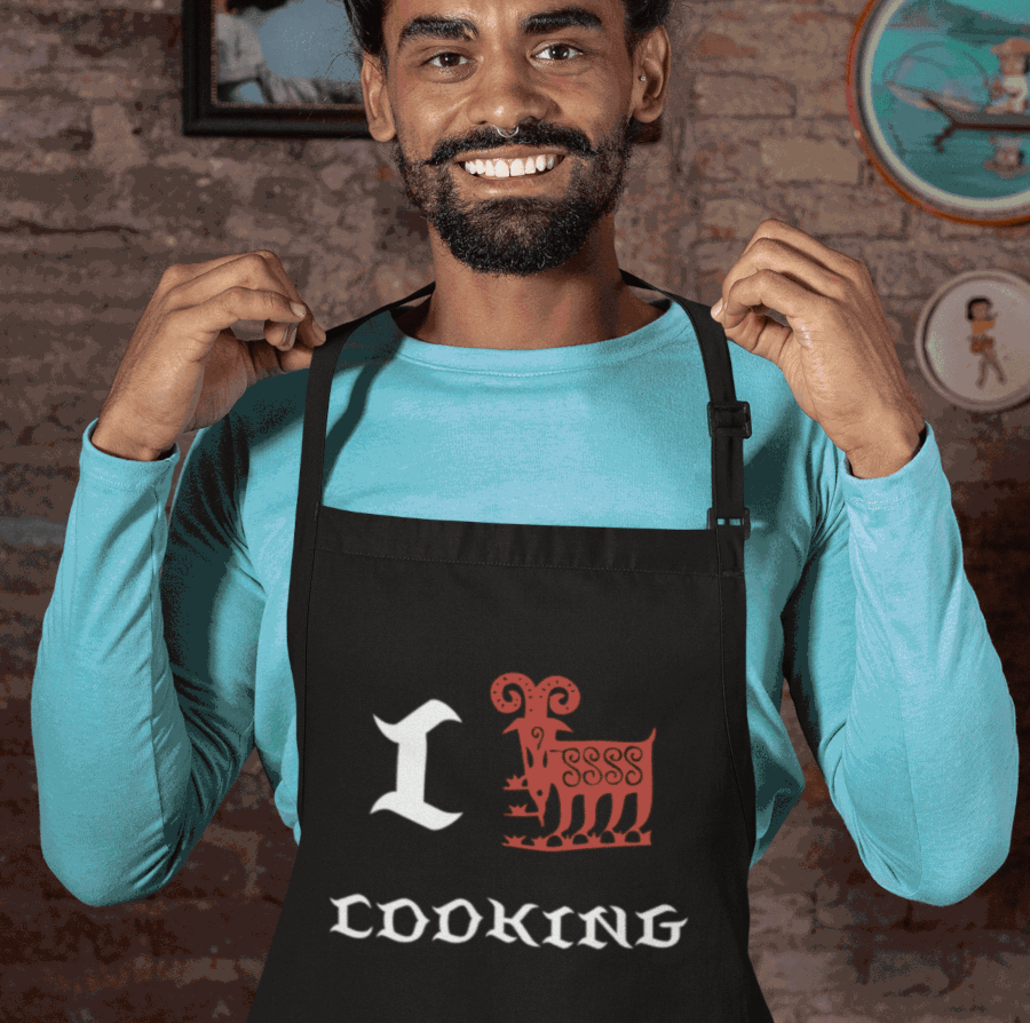 Guy with custom apron and Capricorn design