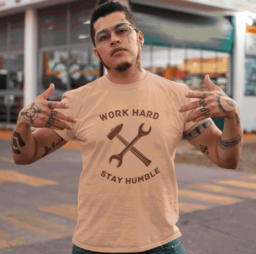Guy wih tattoos and custom T-shirt