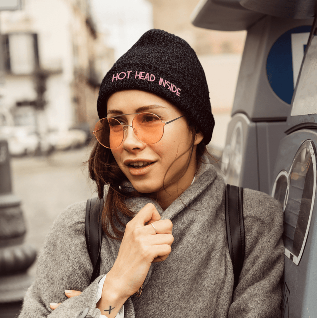 Girl with custom winter cap and glasses