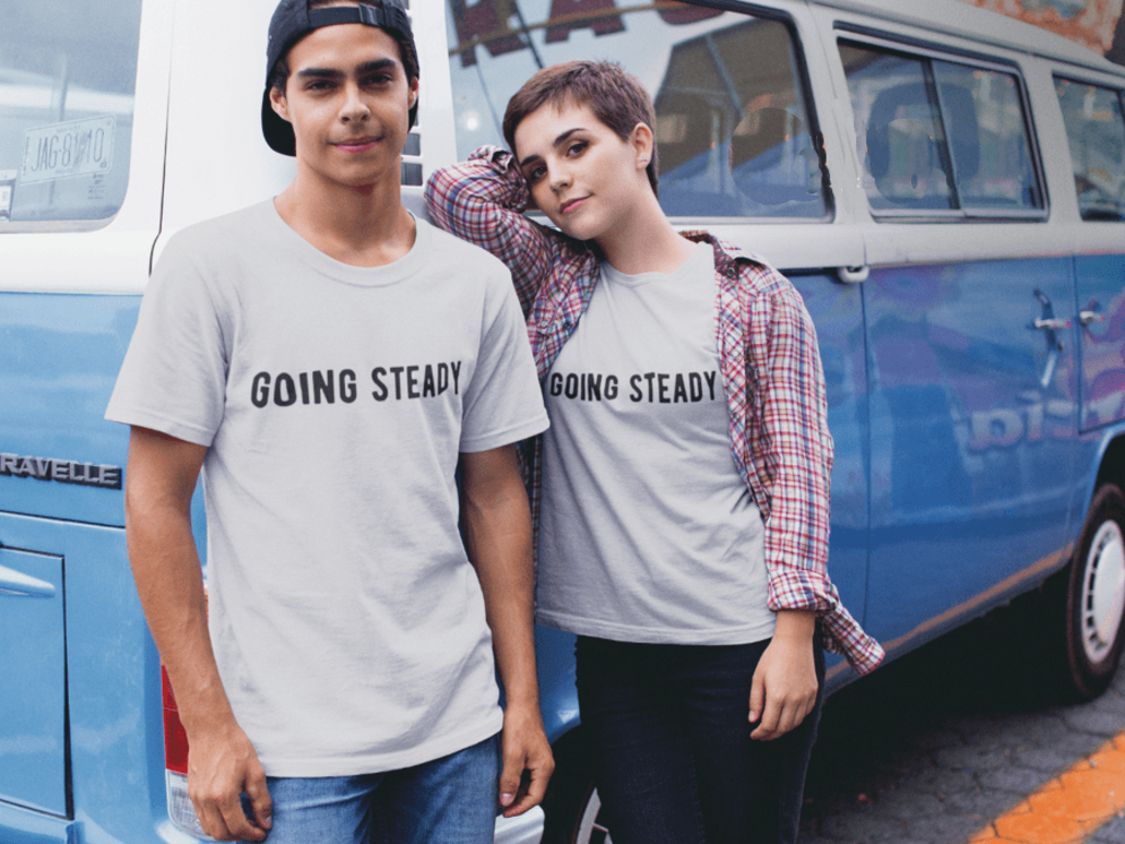 Couple with matching T-shirts and camper van