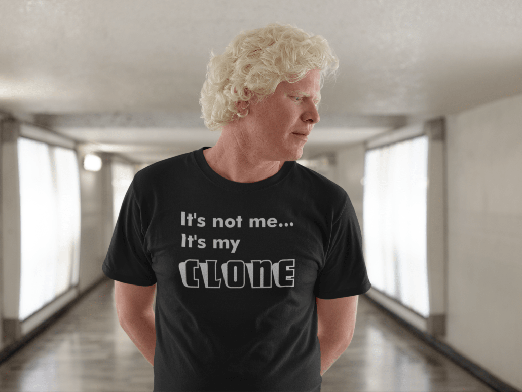 a man with white curly hair in a hallway